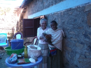 Hila Bram presents a chicken to one of the Meketa beneficiaries.