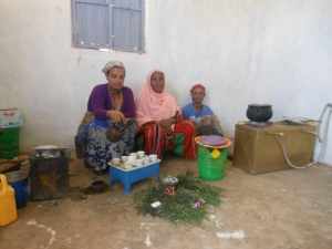Residents sitting by in of the four gas stoves