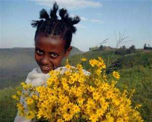 A girl with traditional Enkutatash wild flowers!  Image from http://bit.ly/1wg2p8I