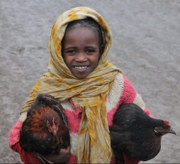 Young girl cuddling her chickens!